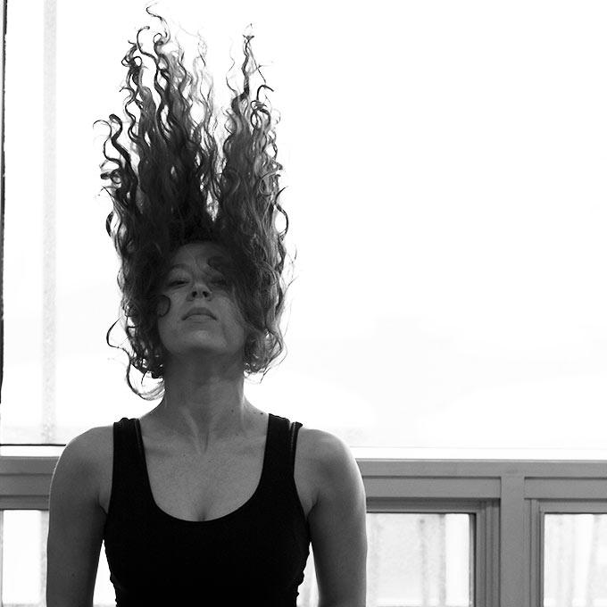 Girl flinging hair in the air