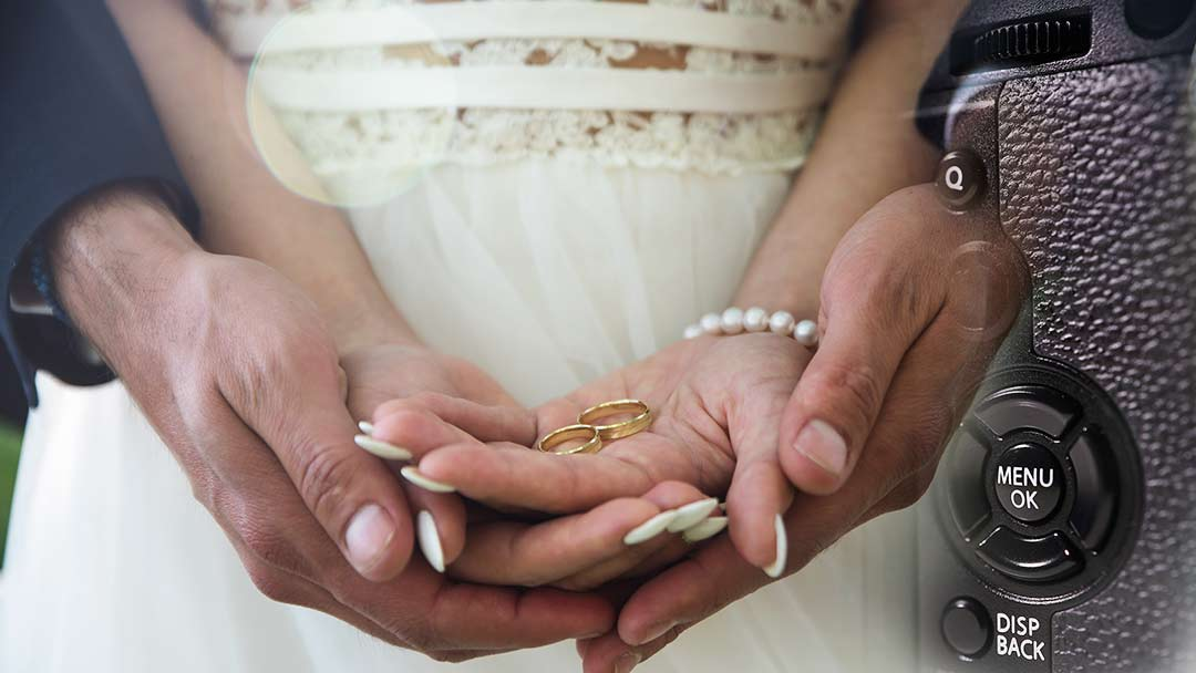 wedding couple's hands and xt3 menu