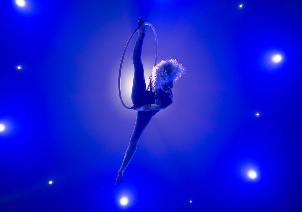 Aerial hoop artist posing in splits