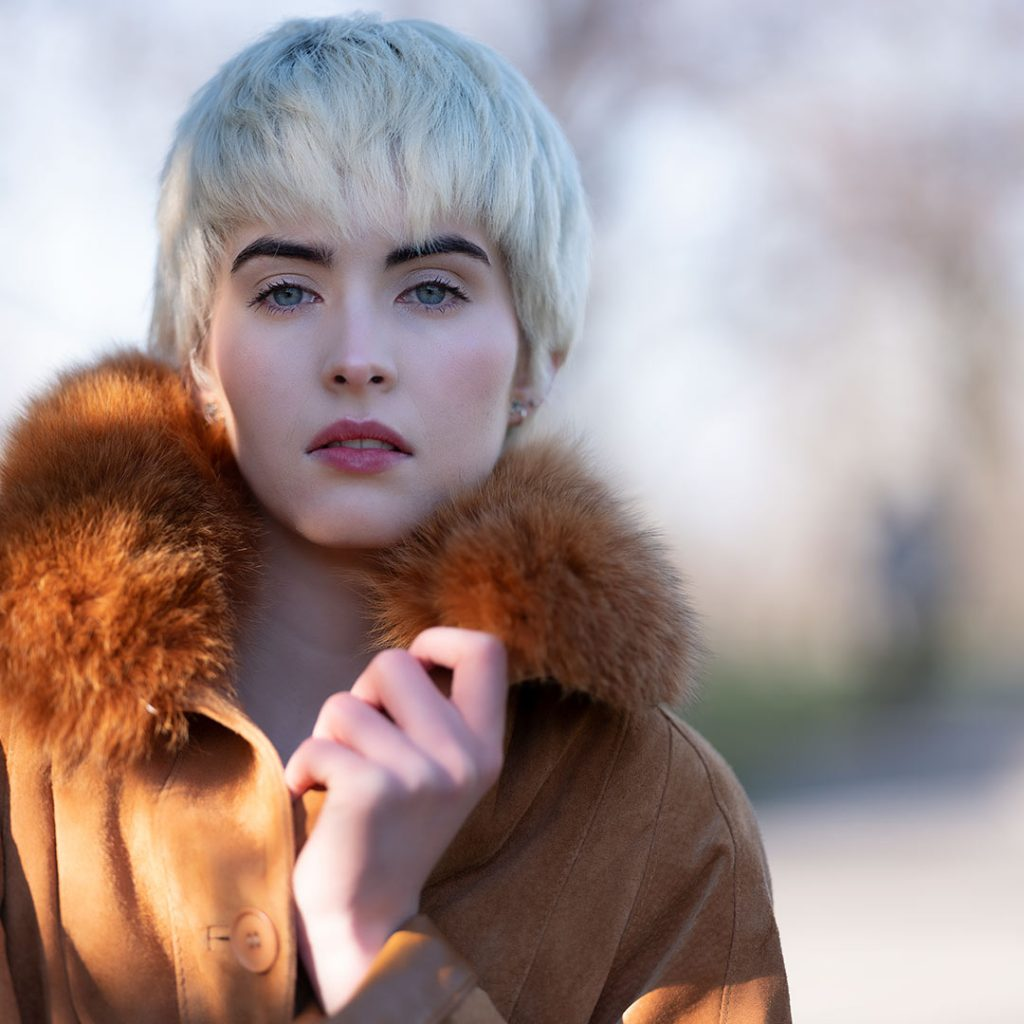 Portrait of a blonde woman with a fur coat