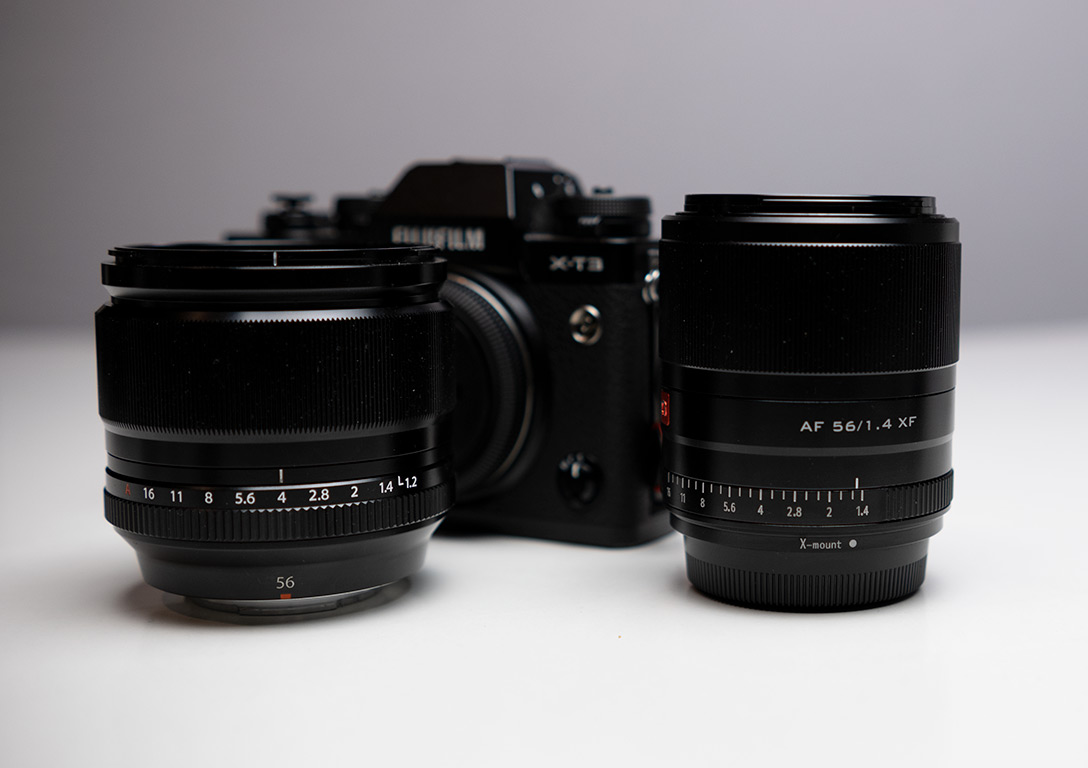 Two 56mm lenses in front of a Fujifilm camera