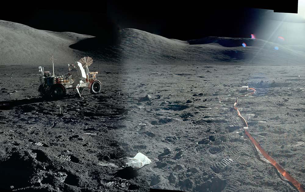 photo of moon lander with astronaut far away