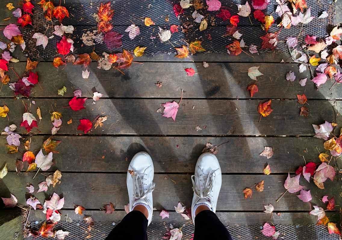 Feet standing on a wooden deck