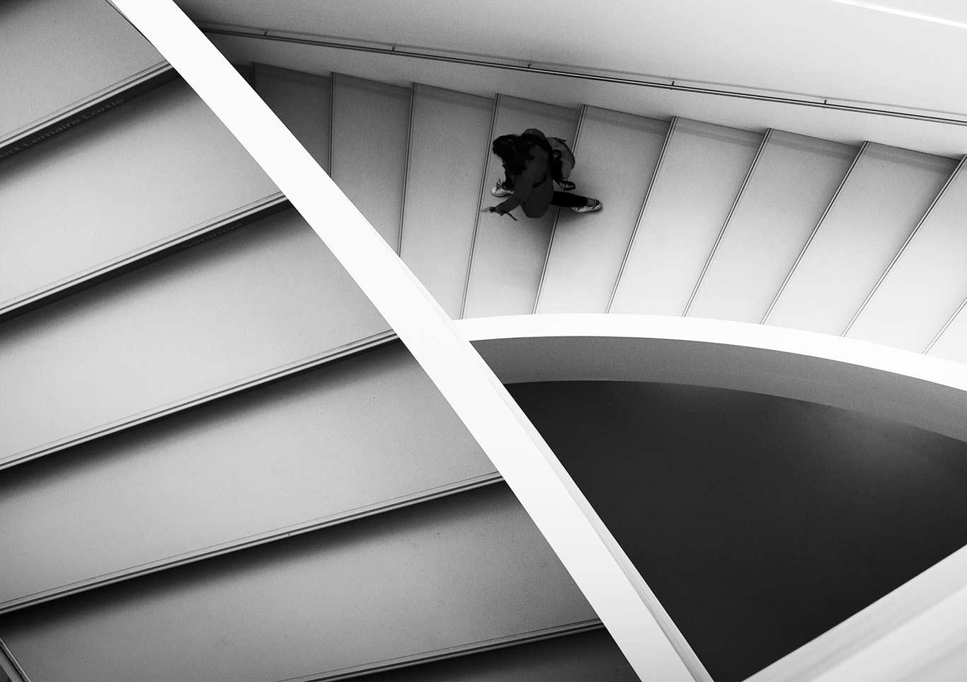 Woman walking down steps- top view