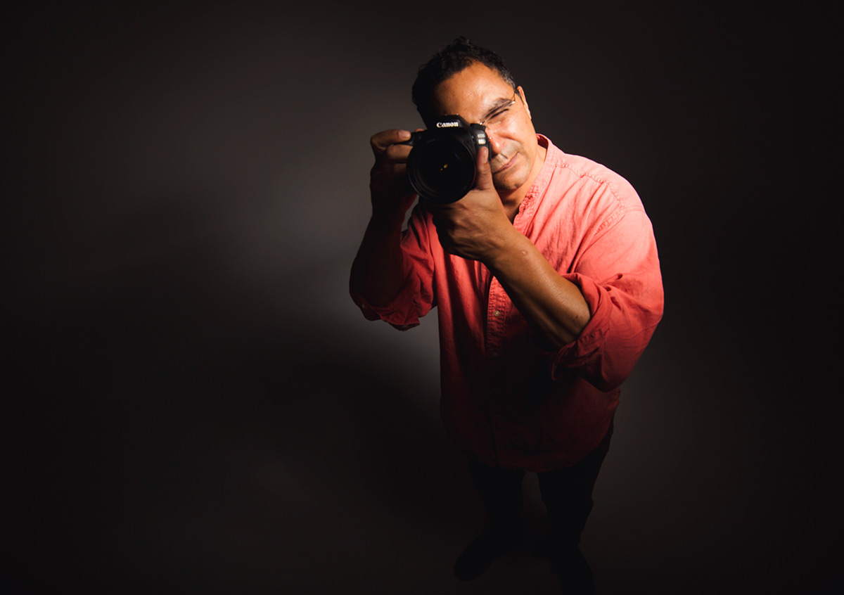 Photo of a photographer holding a camera to his eye