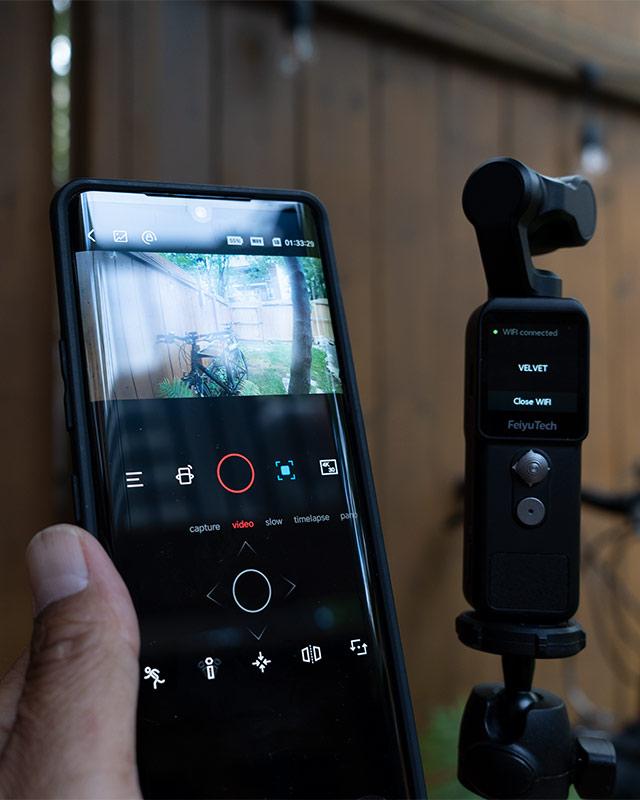 Photo of phone app next to the Feiyu pocket 2 gimbal